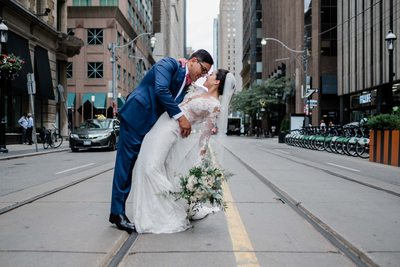 Bride and Groom Kiss in front of King Edward Hotel