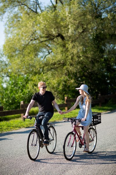 Engagement Photo of a Couple Riding a Bike