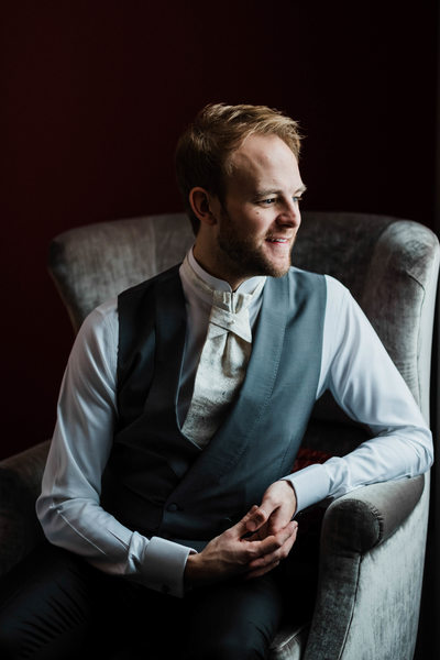 Groom Sitting on Armchair