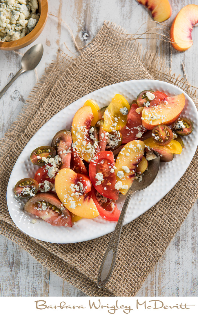 Baby heirloom tomatoes with nectarines and blue cheese