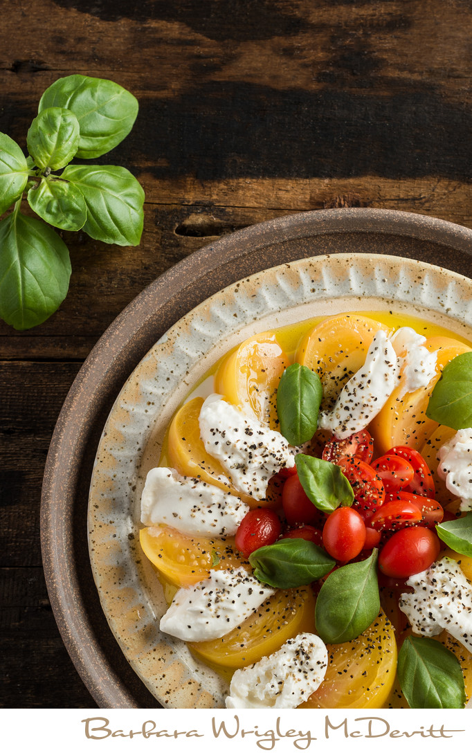 Yellow and red tomatoes with basil and burrata