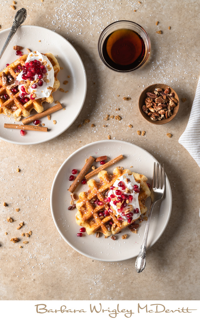 Waffles with fresh cream, cinnamon and pomegranate