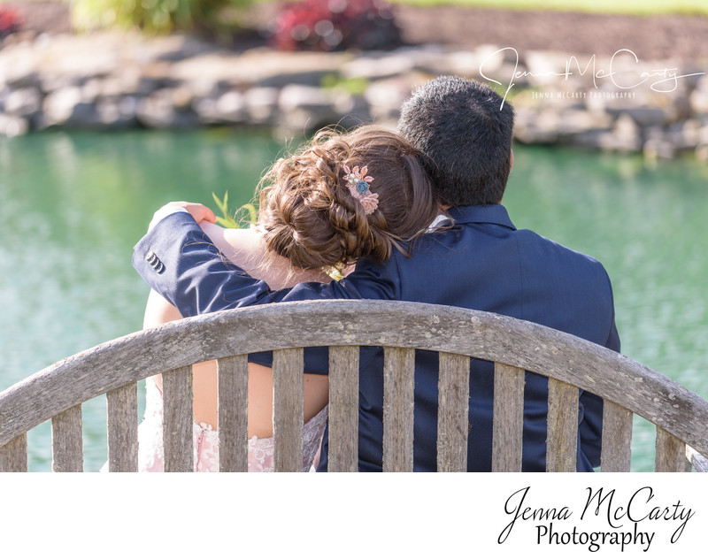 bride and groom looking at pond at relatives house