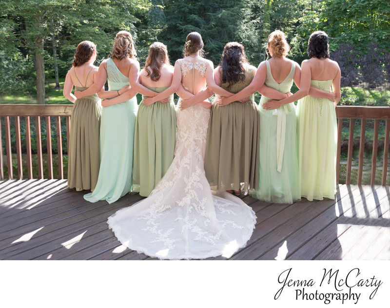Bride and Bridesmaids in different shades of green