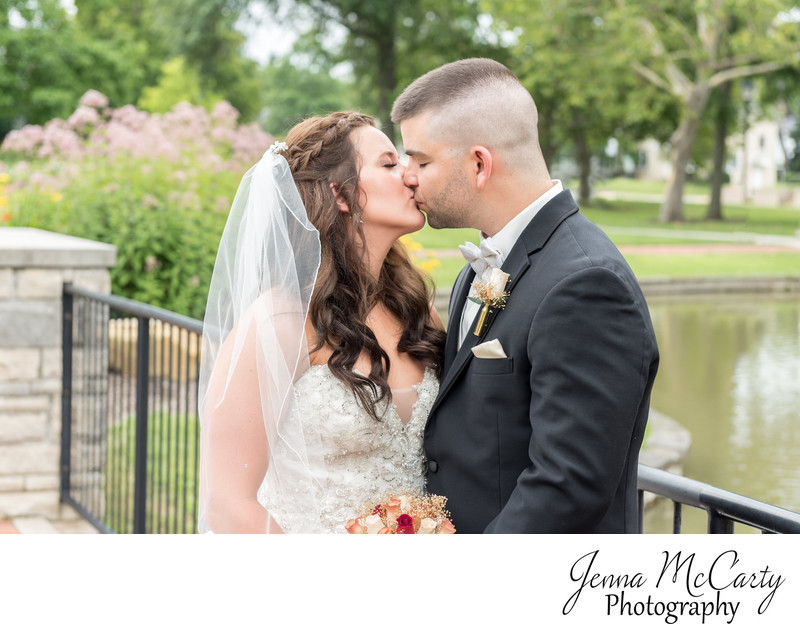 Bride and Groom kissing on Mount Union's bridge in Ohio