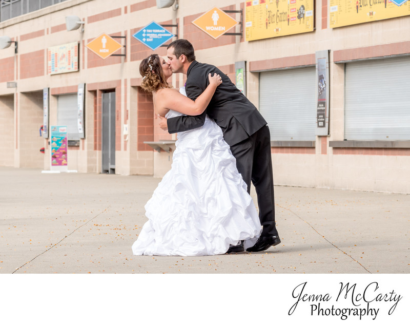 Bride and Groom Kissing in Canal Park in Akron Ohio