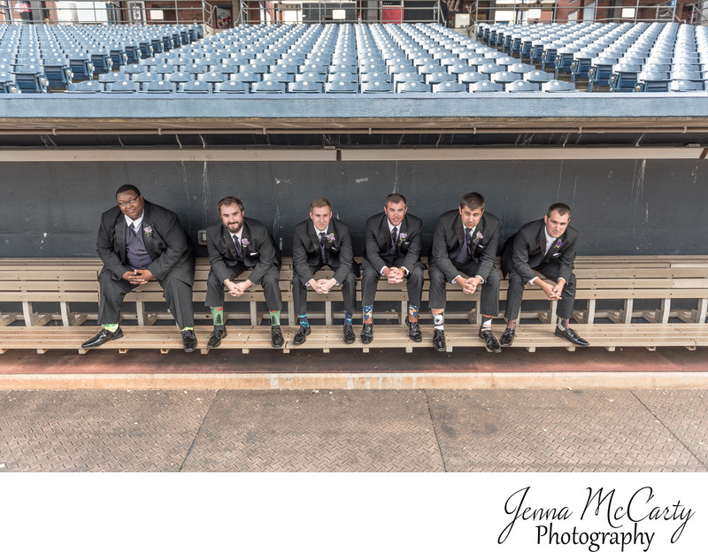 Groomsmen in dugout in Canal Park in Akron Ohio