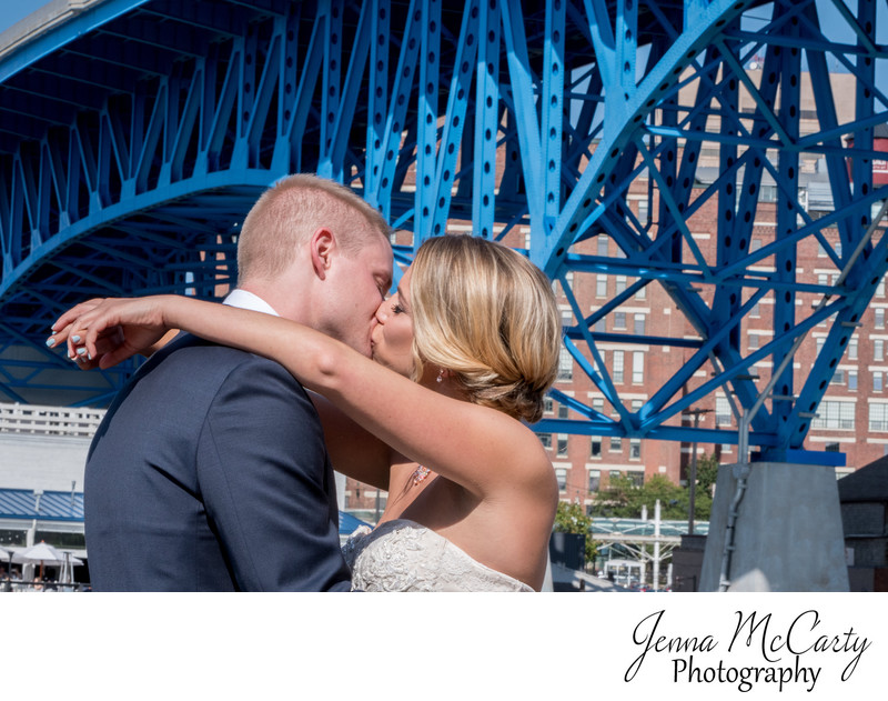 Bride and Groom Kissing in front of the Shoreway Bridge