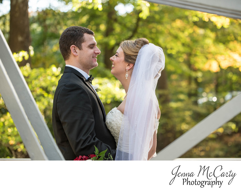 Bride and Groom on suspension bridge in Mill Creek Park