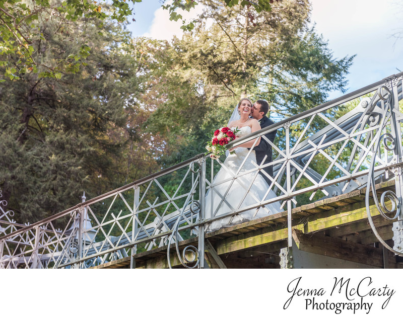 Bride and Groom Goofing Around on Suspension Bridge