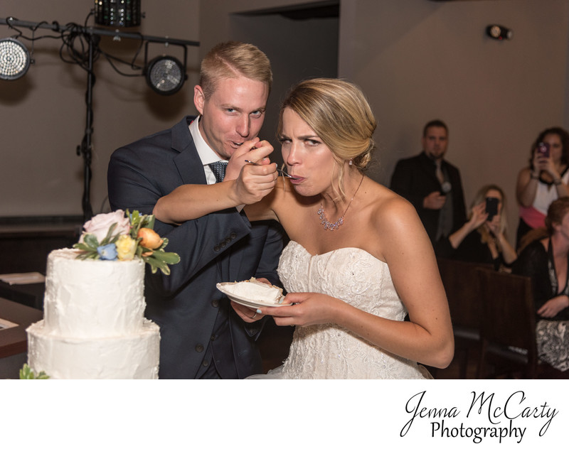 Bride and Groom Eating Cake in Music Box Supper Club
