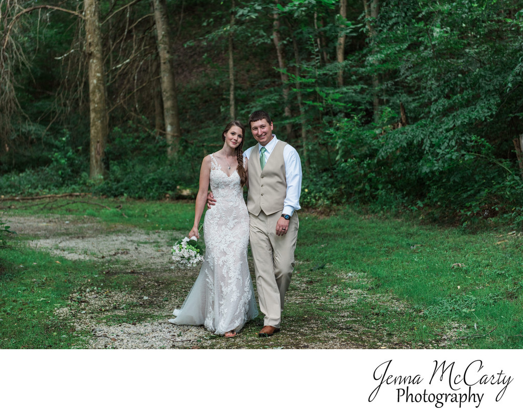 Bride and Groom Walking in the Woods in Mineral City