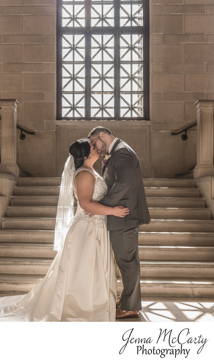 Bride and Groom Kissing in Grand Staircase in Stambaugh