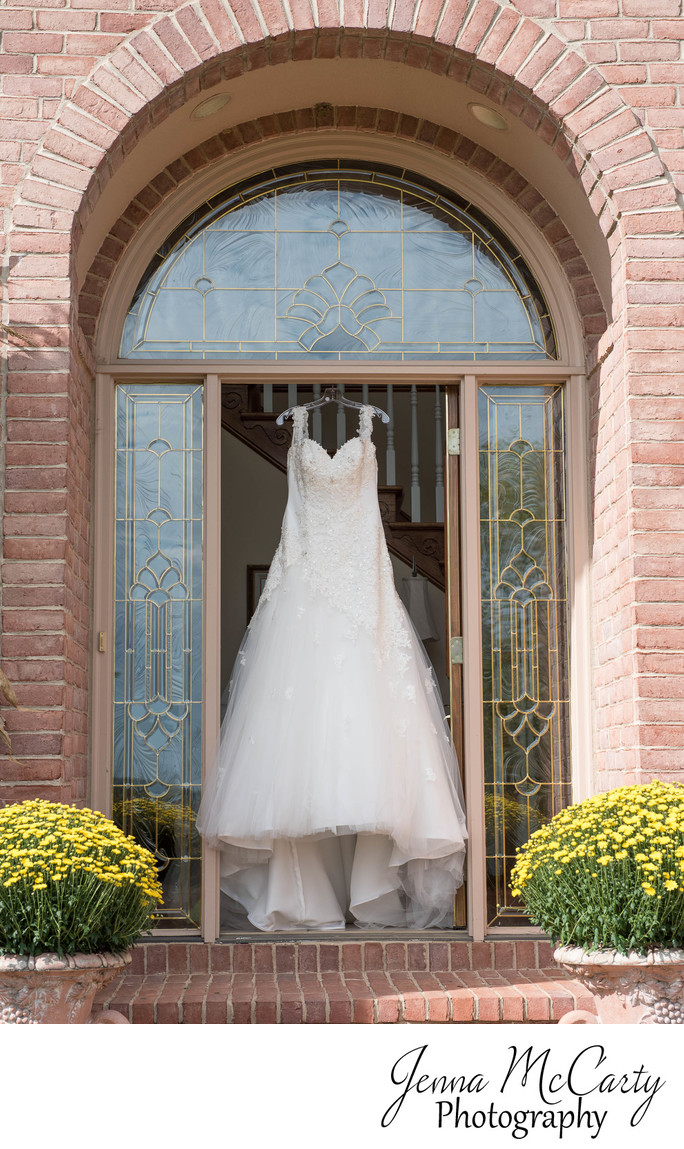 Bridal Gown Hanging in Archway at her Parent's Home