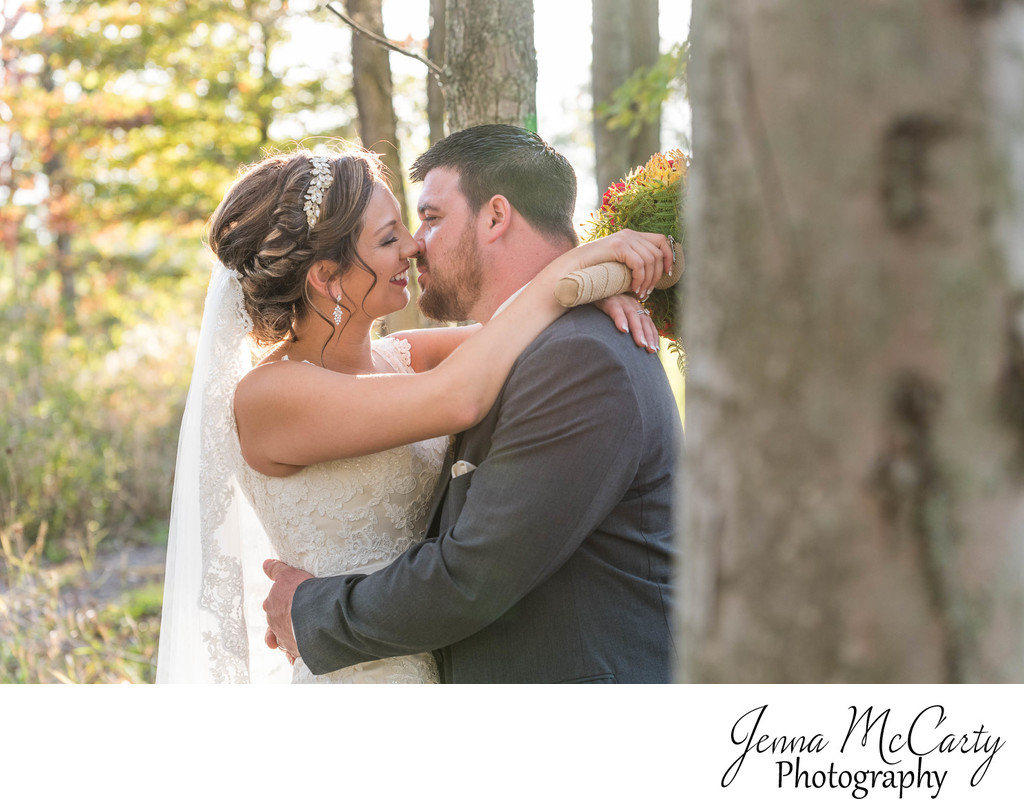 Bride and Groom in Woods During Fall in Ohio