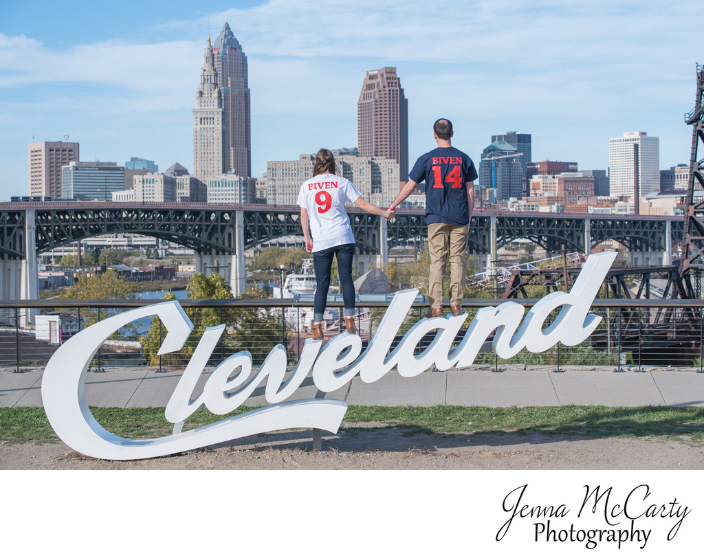 Couple Standing on Cleveland Sign in Cleveland Ohio