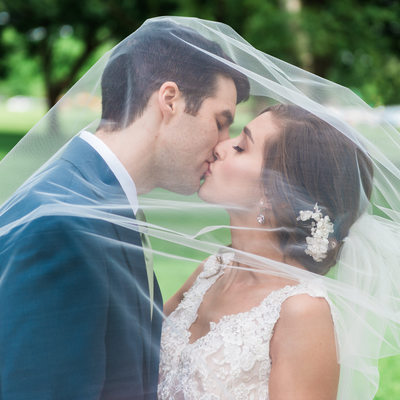 Bride and Groom under the Veil in Edgewater Park