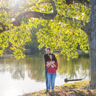 Couple Hugging by the lake in Hudson Springs Park