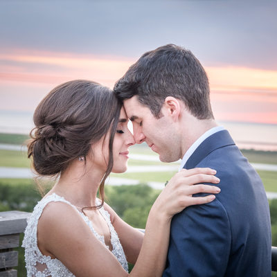 Newlyweds on top of Ariel at Sunset in Cleveland