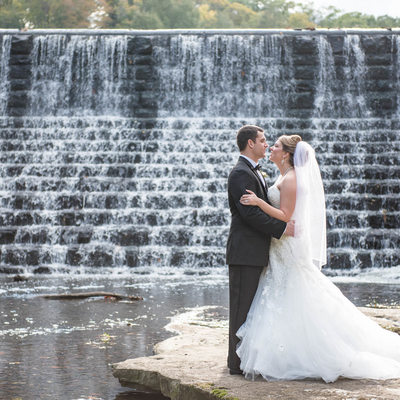 Bride and Groom in Front of Waterfall in Mill Creek