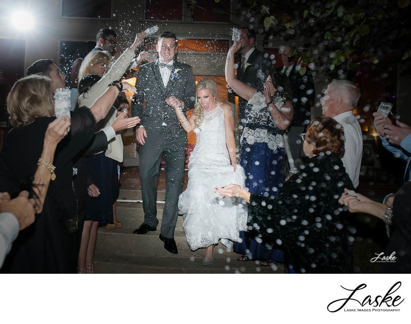 Bride and Groom Showered with Snow As they Exit the Reception at Walnut Creek Chapel