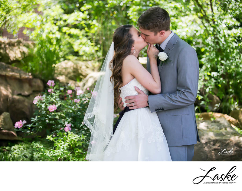 Bride and Groom Kiss After Outdoor Wedding at Dominion House