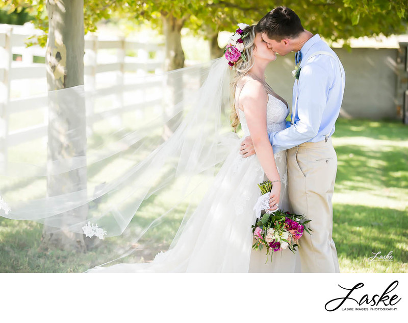 Bride and Groom Kiss Outside