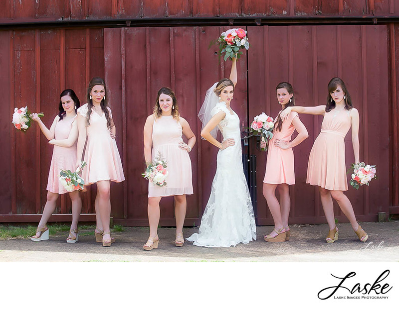 Bride and Bridesmaids Fun Pose Outside Barn Country Wedding