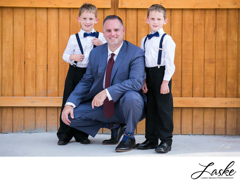 Groom Squats by Twin Boys for Wedding Day Portrait