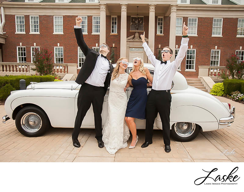 Groom and Best Man Cheer with Bride and Maid of Honor on Wedding Day