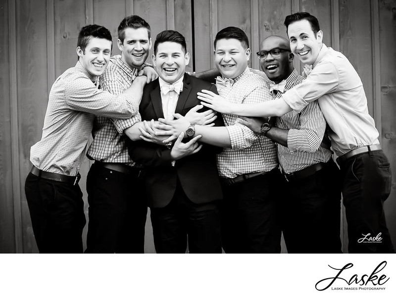 Groomsmen Hug Groom in Wedding Day Group Shot