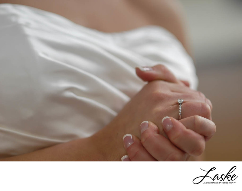 Bride Clasps Her Hands in Anticipation