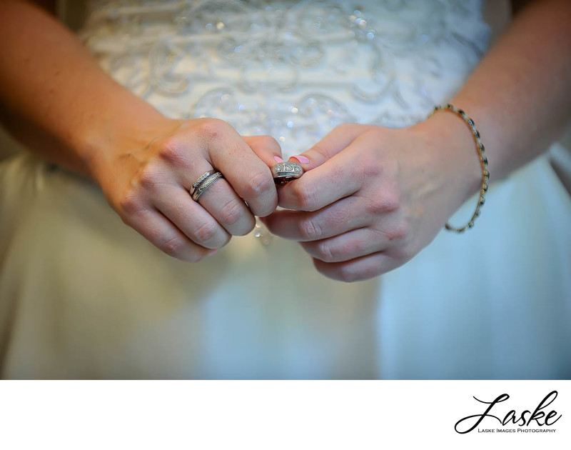 Closeup of Bride holding Groom's wedding band