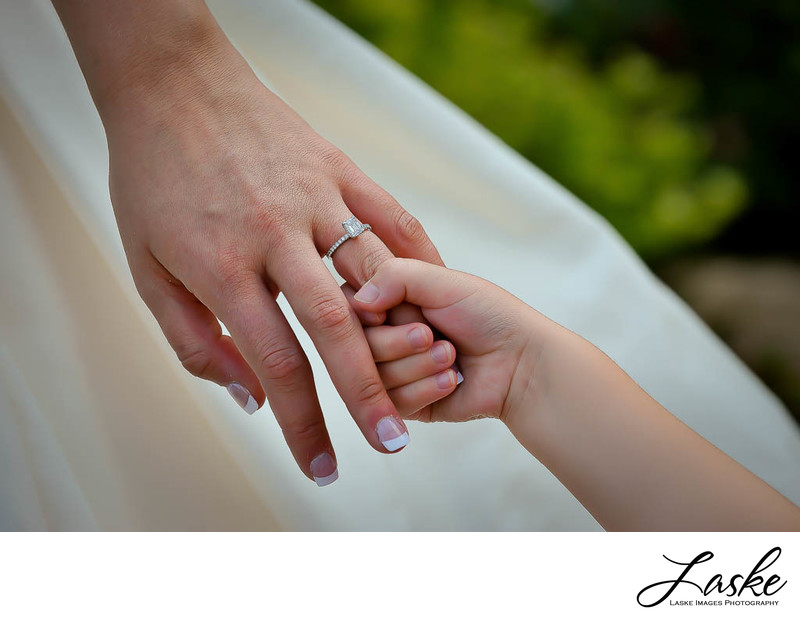 Flower Girl Holds Brides Ring Finger