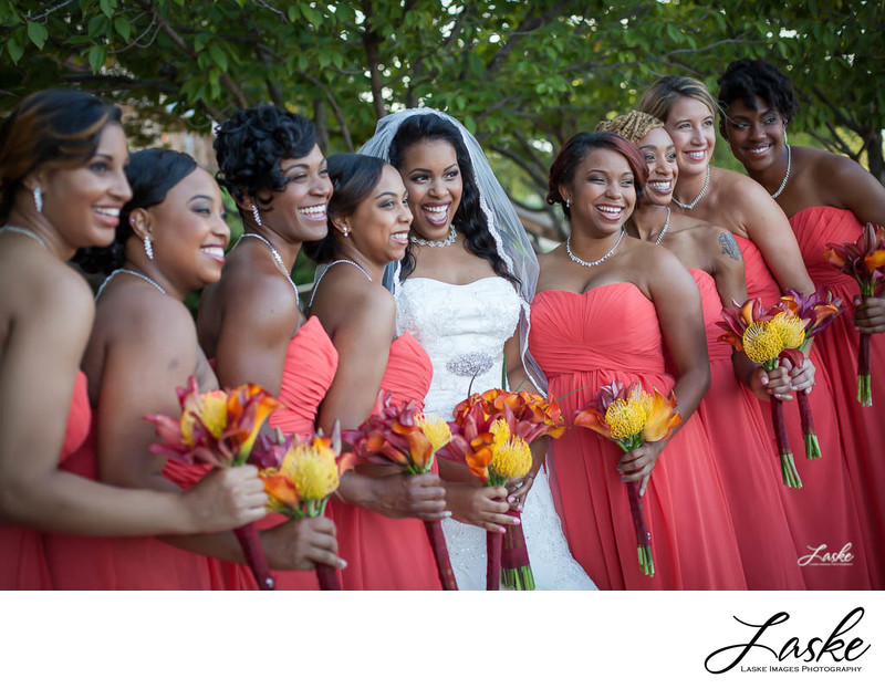 Beautiful Bride Laughs with Her Bridesmaids