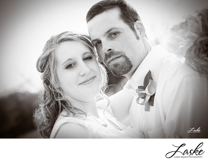 Bride and Groom Cheek to Cheek Sepia