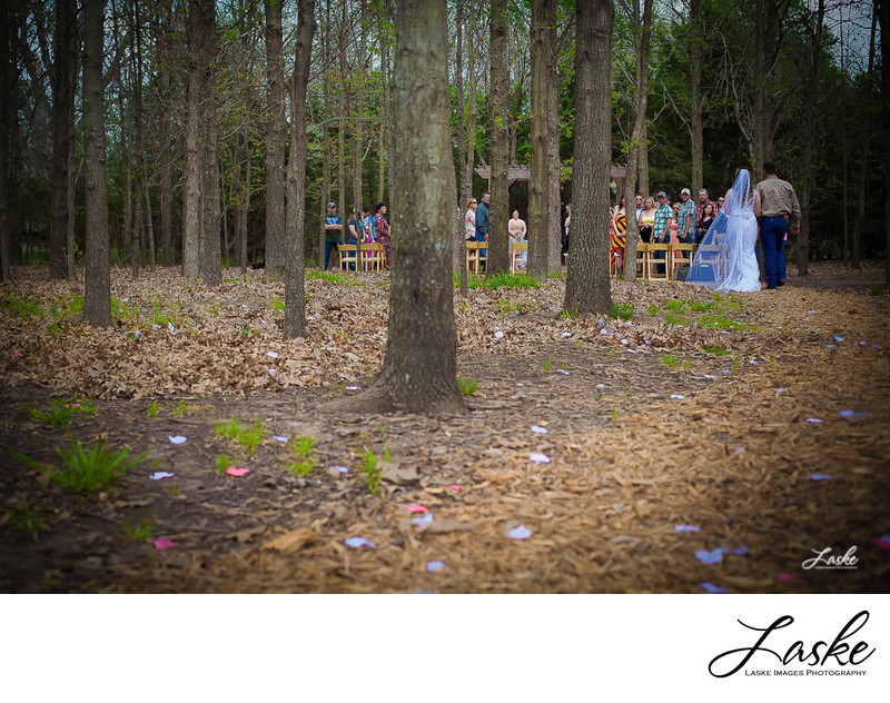 Dad walks daughter down aisle in the woods