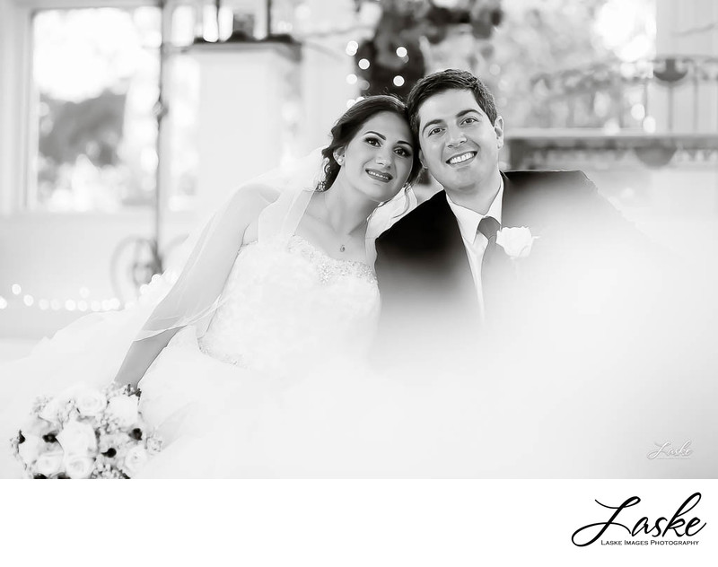 Bride and Groom Lean in For Picture in Black and White