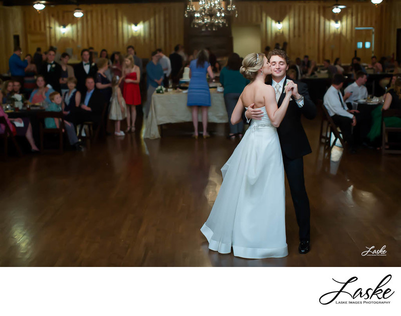Bride Kisses Groom During First Dance During Reception