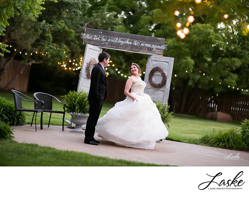 Bride looks back at Groom with Rustic Country Doors