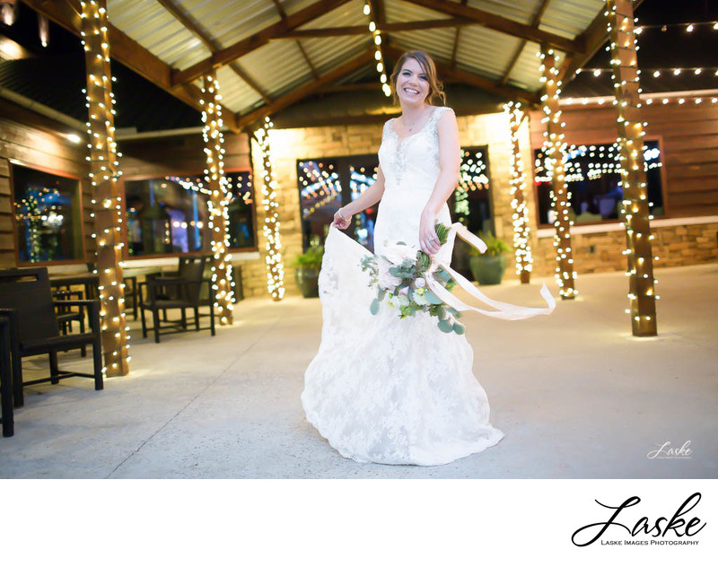 Bride Twirls around in her dress during the reception at Southern Hills in Goldsby, OK.