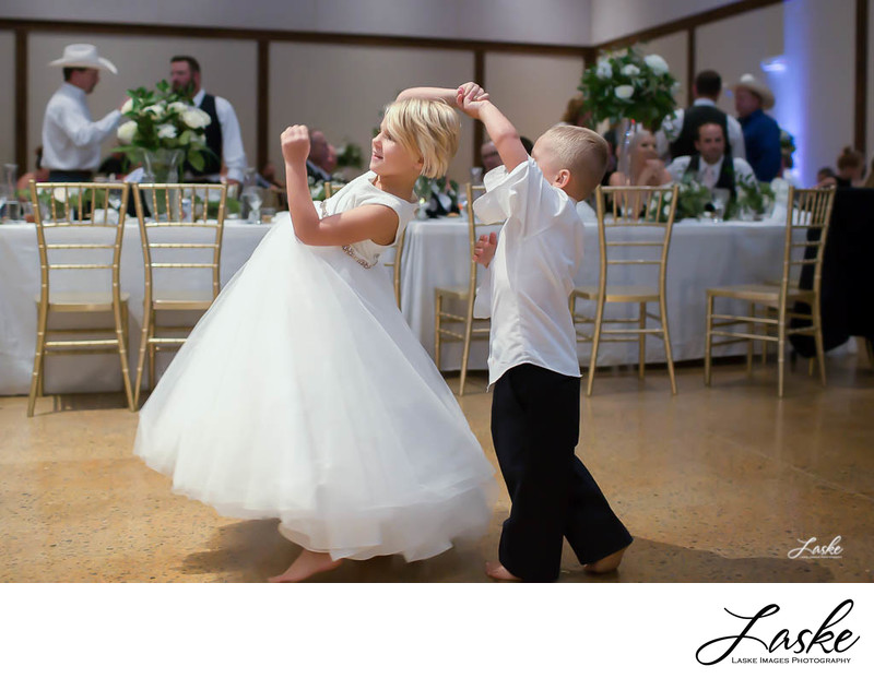 Ring Bearer Twirls Flower Girl Around on Dance Floor