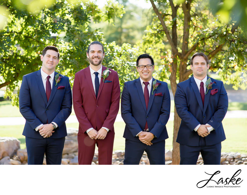 Groom and His Groomsmen Smiling Outside for Wedding Party Pictures