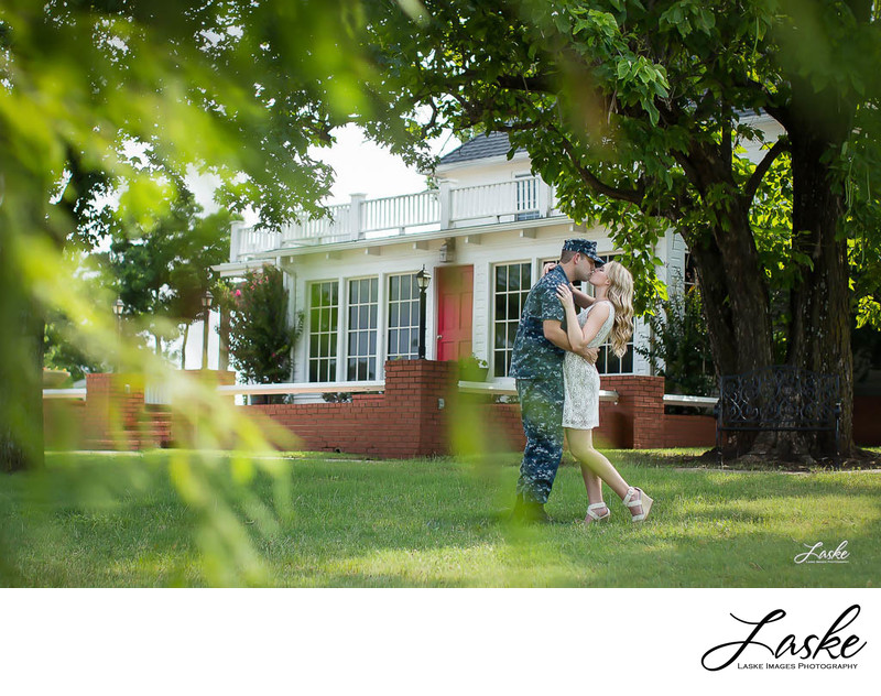 Soldier Holds His Fiance Tight for A Kiss by Oklahoma City Wedding Photographers
