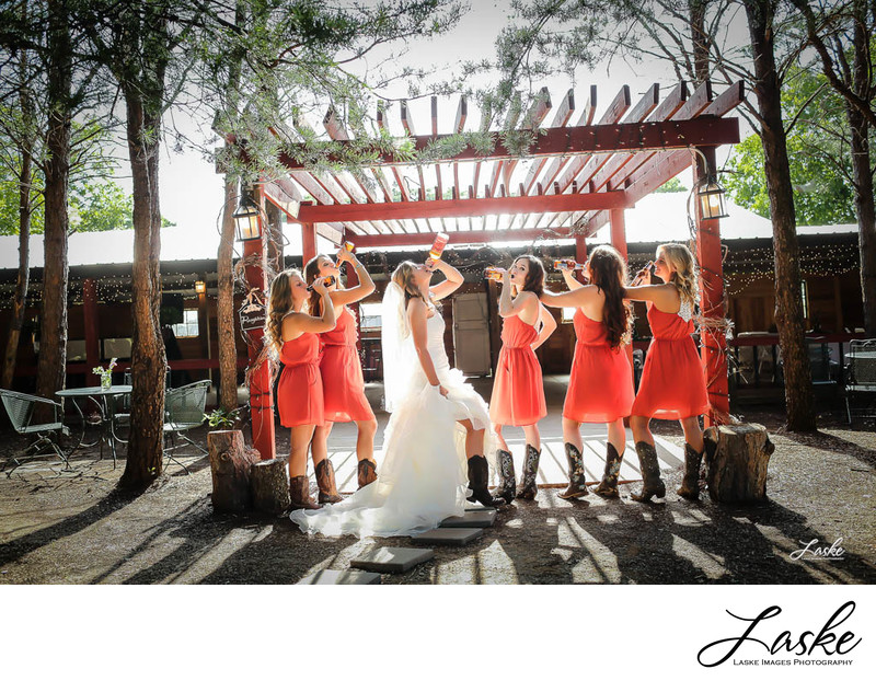 Bride and Bridesmaids Have a Drink to Celebrate Wedding Day by wedding Photographers in OKC