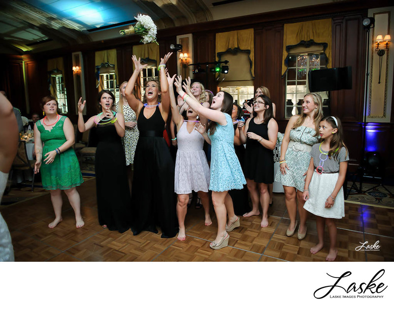 Bridesmaid Catches Bouquet During Wedding Reception