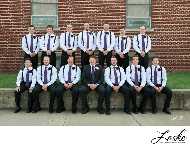 Groom and his groomsmen take picture outside