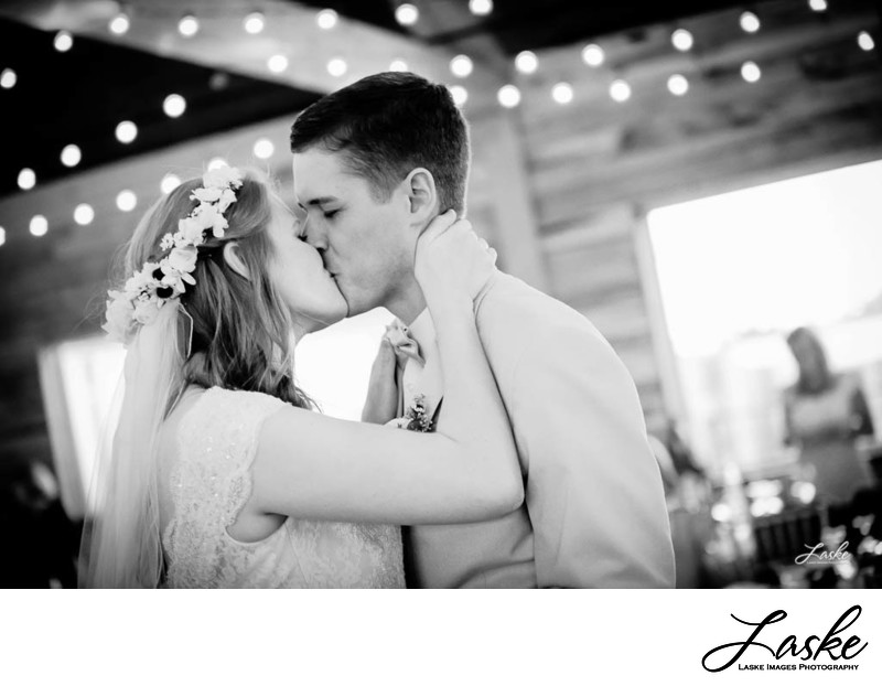 Bride Grabs the Groom for A Kiss During the Reception