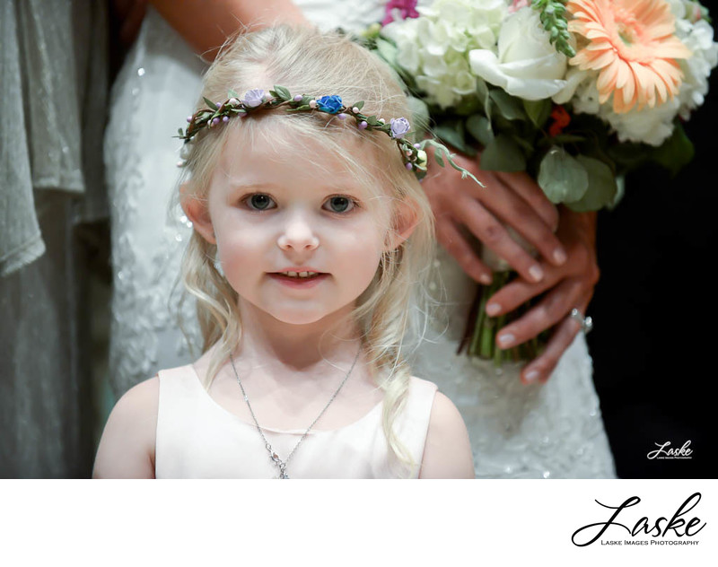 Close-up of flower girl during portraits on wedding day