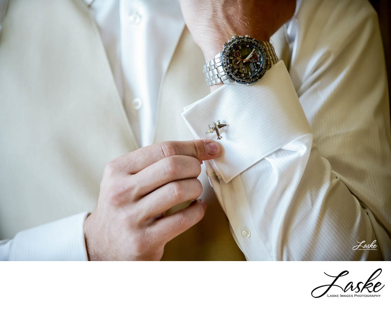 Groom Puts on His Airplane Cufflinks Getting Ready